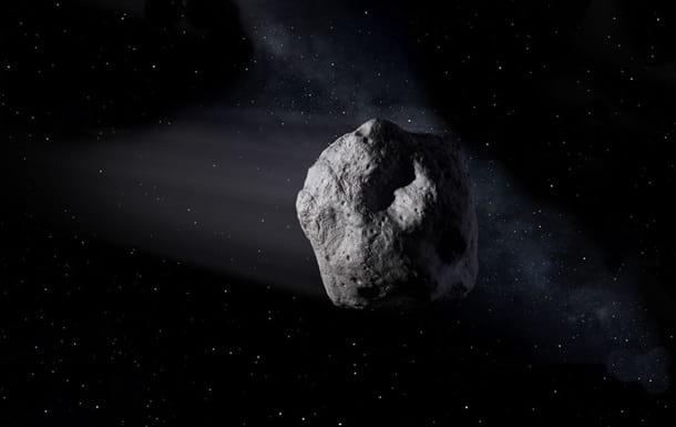 Астероид в космосе фото