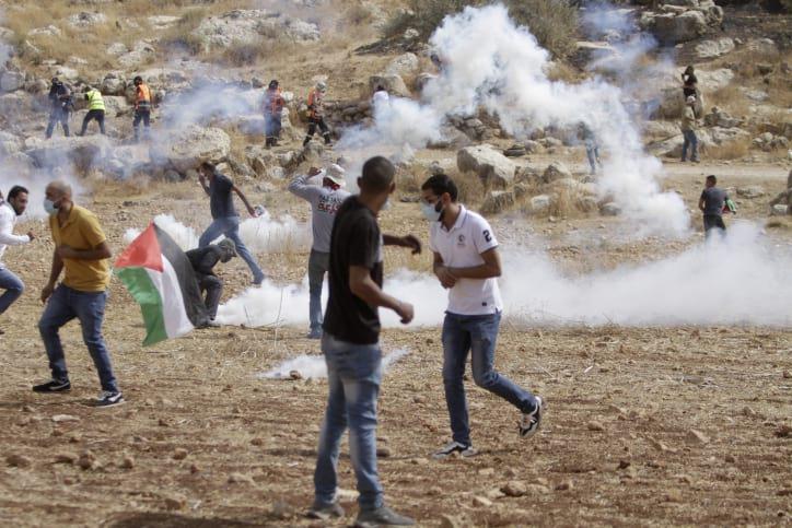 столкновения израильских военных с палестинцами фото